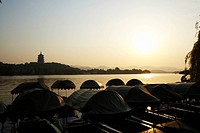 The Six Harmonies Pagoda and small boats, West Lake in Hangzhou, Zhejiang Province, People Republic of China