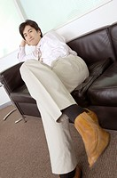 Office worker who relaxes with the sofa