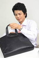 Businessman arranging a bag