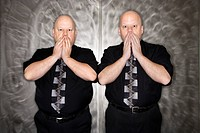 Caucasian bald mid adult identical twin men gasping with hands over mouth