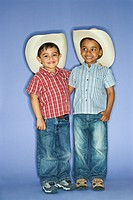 Hispanic and African American male child in cowboy hats
