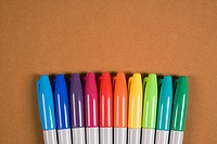 Group of colorful markers lined up in a row