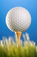 Studio shot of a golfball on a tee in grass (thumbnail)