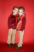 Female children Caucasian twins embrace