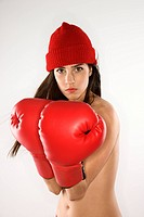 Topless caucasian woman wearing boxing gloves and hat