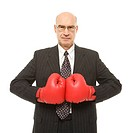Caucasian middle_aged businessman wearing boxing gloves