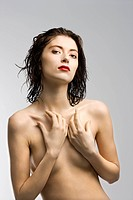 Nude redhead woman with wet hair