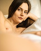 Nude Caucasian mid_adult woman relaxing