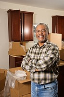 Portrait of middle_aged African_American male in kitchen with moving boxes