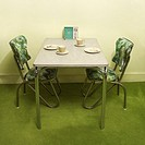 Retro 50's formica and chrome dinette set with green vinyl chairs (thumbnail)