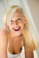 Portrait of attractive blonde Caucasian young adult woman smiling and looking at viewer