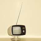 Stilll life of vintage television set with antenna raised