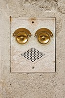 Close_up of ringer and speaker on side of building that look like a face in Venice, Italy