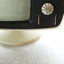 Close_up still life of vintage television set with adjustment knob