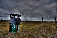 dustbin in the dunes, dark clouds