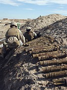 Two combat engineers unearth 82 mm Chinese mortars