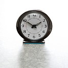 Still life of round vintage alarm clock on table