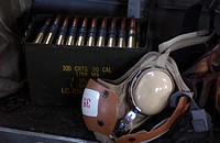 Box of live M2 .50 cal. machine gun ammunition and a cranial lay on a CH_46E Sea Knight