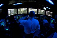 Air Traffic Controller watches as a flight cycle begins on aircraft carrier