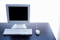 Still life of computer monitor, keyboard and mouse