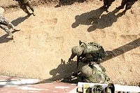 US Marines throws a practice grenade into a room to clear it before they enter during training
