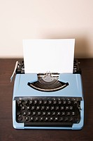 Still life of blank sheet of paper in an old fashioned typewriter