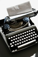 Above view of typewriter with paper