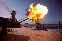 Mark 7 16_inch/50_caliber gun fires off the port side of a battleship