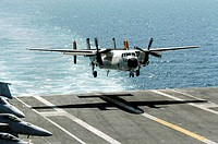 A C_2A Greyhound prepares to land on the flight deck