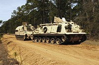 M_88 recovery vehicle begins to tow an M992 field artillery ammunition supply vehicle