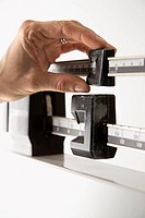 Close_up of female's hand reading her weight on scale
