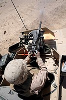 A 40 mm grenade flies from the muzzle of a MK_19 automatic grenade launcher