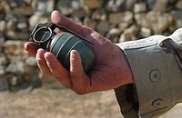 A close up view of an Arges Type HG_84 fragmentation grenade