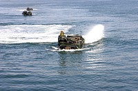 Amphibious assault vehicle drives toward the coast