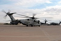 A CH_53E Super Stallion helicopter taxies down the flight line
