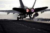 An F/A_18C Hornet rockets down the flight deck