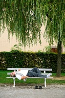 sep 2008 - Man relaxing on a bench under a tree, Saverne, Alsace, France