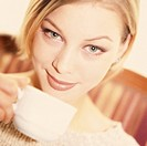 young woman drinking a cup of coffee