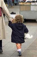 Girl Holding Hand of Parent
