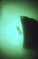 Diver on bows of German Light Cruiser Coln II, Scapa Flow, Orkney islands, Scotland, UK