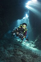 Diver in cave. St Johns, Egyptian Red Sea, light rays. 30_9_07