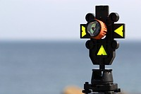 Close up of prism target used during surveying with laser instruments