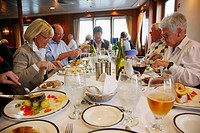 People eating on board the Clipper Adventurer cruise ship sailing in Greenland