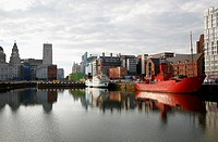 The red light ship at canning dock next to Albert dock with the Liver building in the background, Liverpool, England, UK
