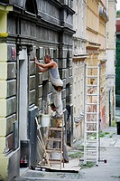 Men Plastering a house wall in Zizkov, Prague, Czech Republic