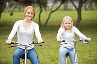 Young woman and her child riding bicycle