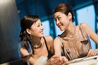 Two Young Women Dining at Fine Restaurant