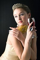 Teenage girl wearing jewelries holding a glass of wine