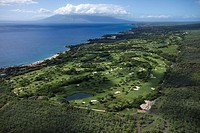 Aerial of golf course on Maui, Hawaii coastline with Pacific ocean