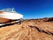Landscape of motorboat sitting in the middle of the desert in rural Arizona, United States